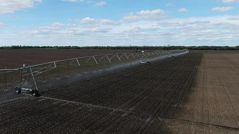 Aerial footage of the watering system in the field, sprinkling machine, 4k Live Action