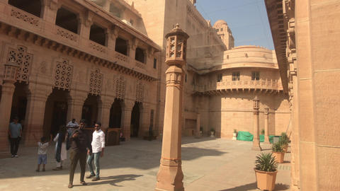 Jodhpur, India - November 06, 2019: Umaid Bhawan Palace tourists stand in the Live Action