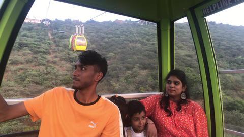 Udaipur, India - November 12, 2019: Mansapurna Karni Mata Ropeway tourists ride Live Action