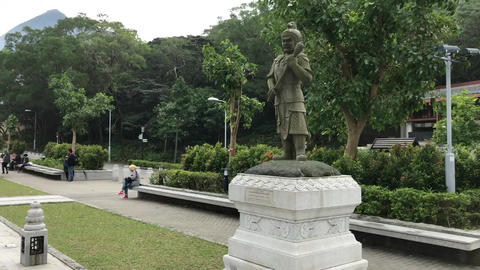 Hong Kong, China, A statue of a person in a garden Live Action