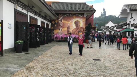 Hong Kong, China, November 20 2016: A group of people walking in front of a Acción en vivo
