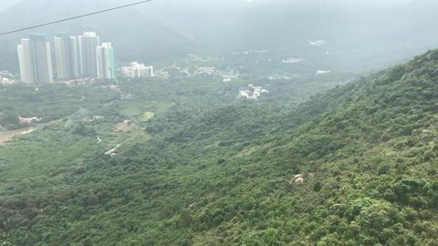 Hong Kong, China, A view of a city with a mountain in the background Acción en vivo