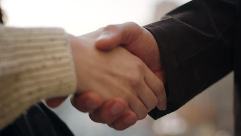 Unknown people shaking hands each other outdoor. Couple hands greeting on street Acción en vivo