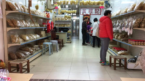 Hong Kong, China, November 20 2016: A person standing in front of a store Live Action