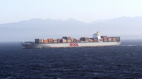 View of cargo ship sailing through the ocean Live Action