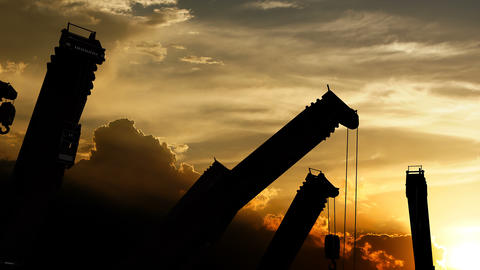 Idle construction cranes over sunset Animation
