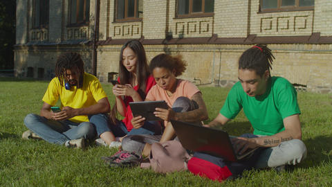 Multiethnic students studying with digital devices Live Action