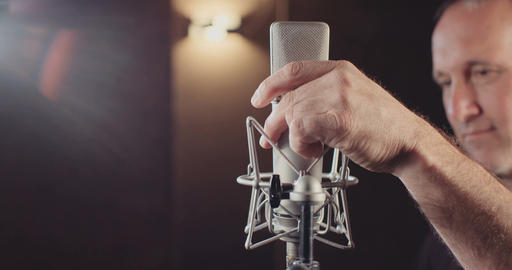 Sound engineer installing and connecting a microphone in a recording studio Footage