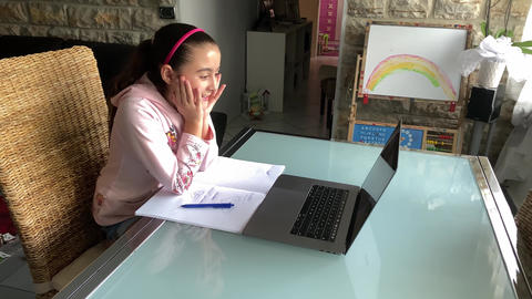 Distance Learning concept. Schoolgirl following course on the laptop with Live Action