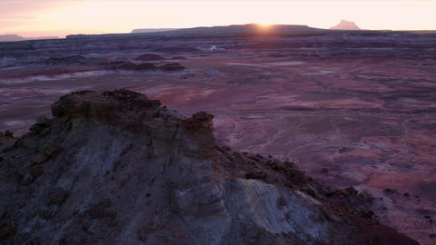 Colorful sunset over Mars type terrain flying towards the ground Live Action