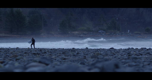 Surfer Walking on Rocky Beach 4k 60fps Live Action