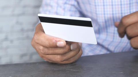 Close up of man hand holding credit card Live Action