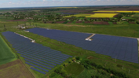 Nature, fields and plants all around a solar power plant in the field, 4k Live Action
