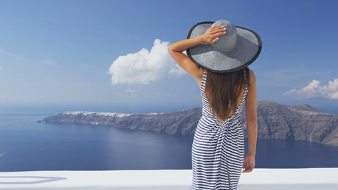 Vacation woman luxury travel looking at Santorini Live Action