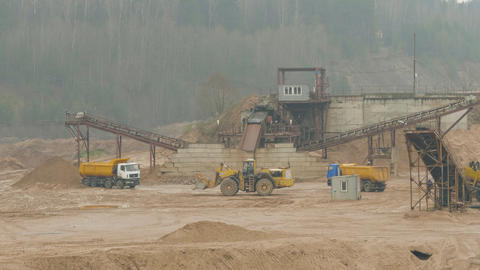 Trucks machine works in the sand ballast quarry on the cloudy summer day ライブ動画