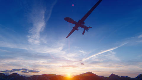 A military drone flies over a desert mountain plain at sunset Animation