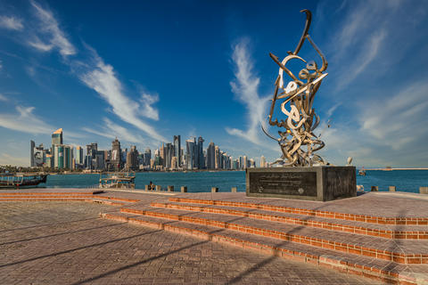 Doha Qatar skyline daylight view with Calligraphy sculpture in foreground フォト