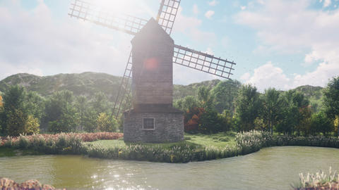 A traditional village windmill stands by the pond against the background of mountains and clouds on Animation