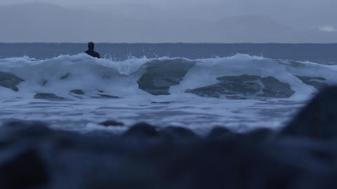 Surfer Sitting on Surfboard in the Ocean With Waves Breaking 4k 60fps Live Action