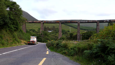 Truck driving past Gleensk Viaduct in Ireland Live Action