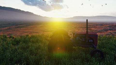 An old tractor stands near a field at sunset in the evening. Agriculture and environment Animation