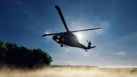 A Blackhawk military helicopter lands on a dusty road on a clear day in a deserted area Animation
