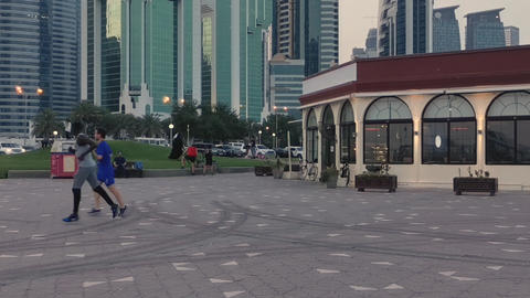 Hyper-lapse of Doha cor-niche at sunset from The promenade Live Action