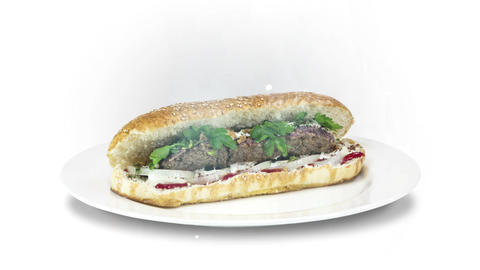 Lule Kebab in bread on white plate on white background Live Action