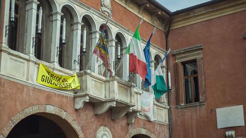 Italian and european flag on historical building in Rovigo, Italy Live Action
