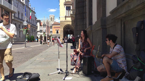 Couple of Street Musician artists plays on Padua streets in Italy 18 Live Action