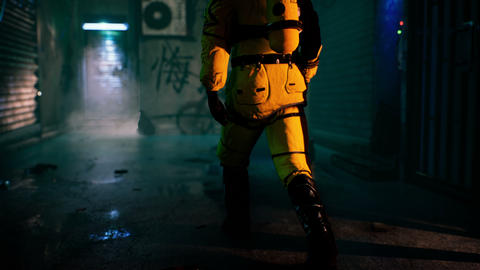 A medic in a bacteriological protection suit returns home. Man in yellow protective suits and gas Animation