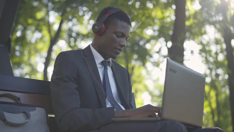 Cheerful African American man listening to music and surfing Internet. Portrait Live Action