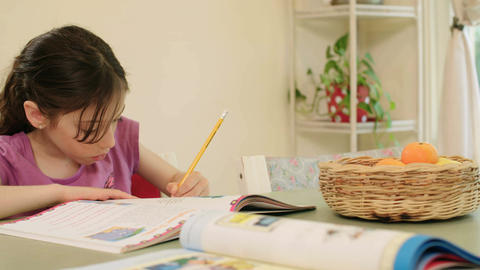 Young girl having trouble preparing homework Footage