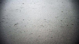 Rain falling on the ground during a storm Footage