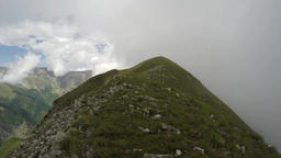 Time lapse of a mountain ridge in the clouds Footage