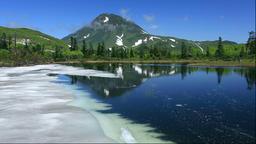 Snow at Sannonuma pond and Mount Rausu, Hokkaido, Japan Footage