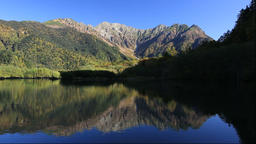 Autumn foliage and the Hotaka mountain range from Kamikochi in Nagano Prefecture Footage