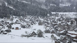 View of the snow covered Shirakawa Village from Shiroyama Observatory Deck, Gifu Footage