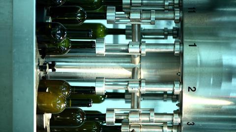 conveyor of wine bottles at wine factory, white wine bottling, vertical footage ライブ動画