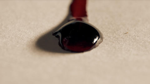 Red blood drops flows on the white paper, macro shot ライブ動画