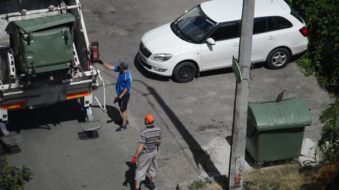 KYIV, UKRAINE - JULY 23, 2020: Garbage collection by the management company in the yard Live Action