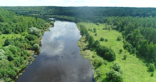 Beautiful panoramic landscape a calm river surrounded by green forest, Top view 4K Live Action