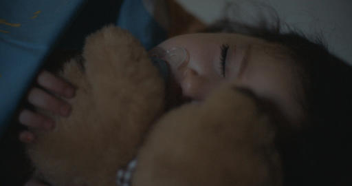 Little girl sleeping hugging her teddy bear Footage