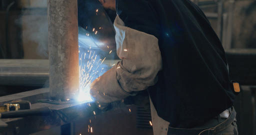 Welder welding metal parts in a metal workshop Footage