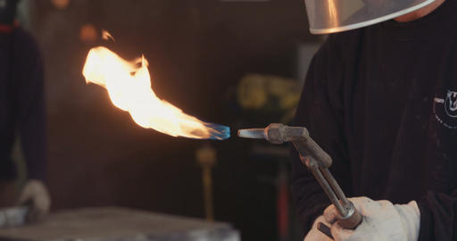 Workers using a torch in a metal workshop Footage