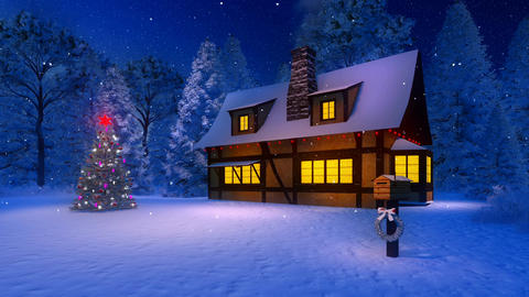 Illuminated cozy house and christmas tree at snowy night Footage