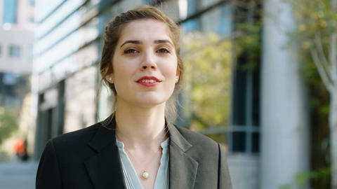 Young business woman standing on the street smiling to the camera Footage