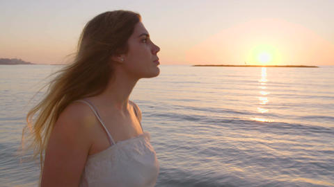Young attractive woman walking on the beach during sunset Footage