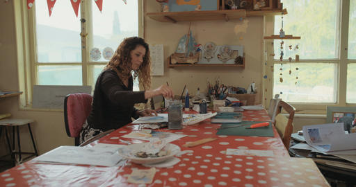 Female artist painting and drawing in her studio Footage