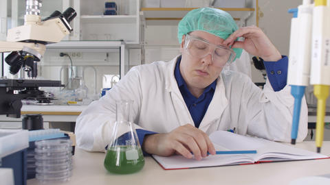 Medical Scientist Stressed out in Laboratory Live Action